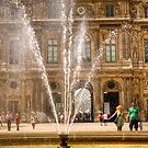 A couple get sprayed by water at the Louvre in Paris by Elana Bailey