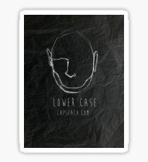 lower case in scrunched up paper black Sticker