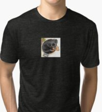 Female Rottweiler Puppy Curled In A Food Bowl Tri-blend T-Shirt