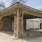 The Petrified Gas Station in Itasca, Texas by Terence Russell