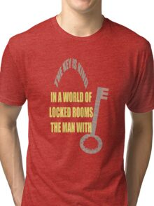 The man with the key is KING Tri-blend T-Shirt