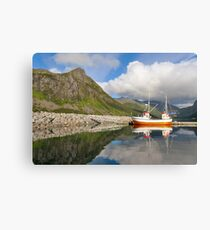 Small fishing boat in the harbor of the fjord Canvas Print