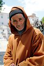 Hooded Man Chefchouen Morocco by Debbie Pinard