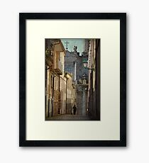 The angel and the priest Framed Print