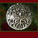 Christmas card with silver bauble by Cheryl Hall