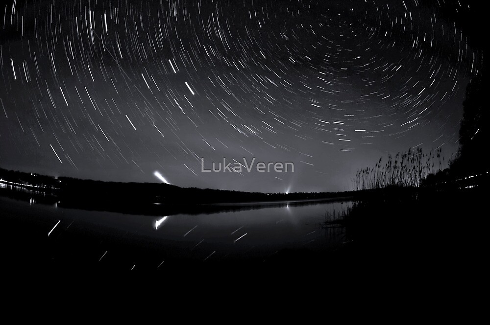 Star trails over the lake by LukaVeren
