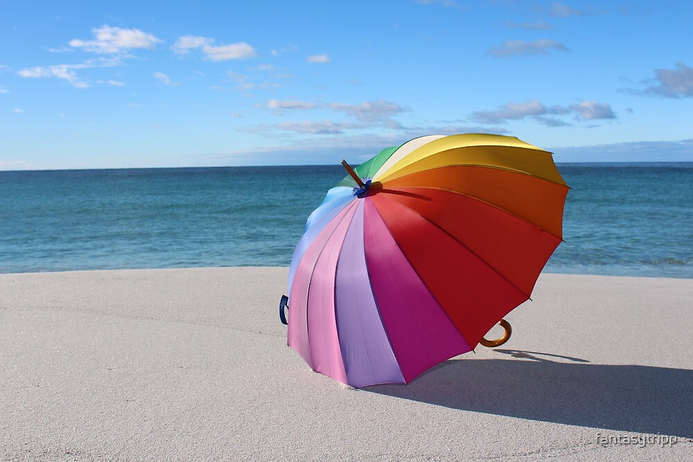 Photo of Rainbow Umbrella on a beach at the Gardens - East Coast Tasmania by fantasytripp