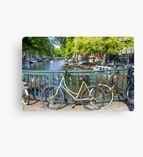 Amsterdam canal and bikes Canvas Print