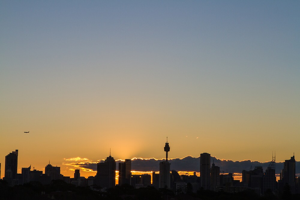 Sunset over the city in Sydney by Justine Gordon