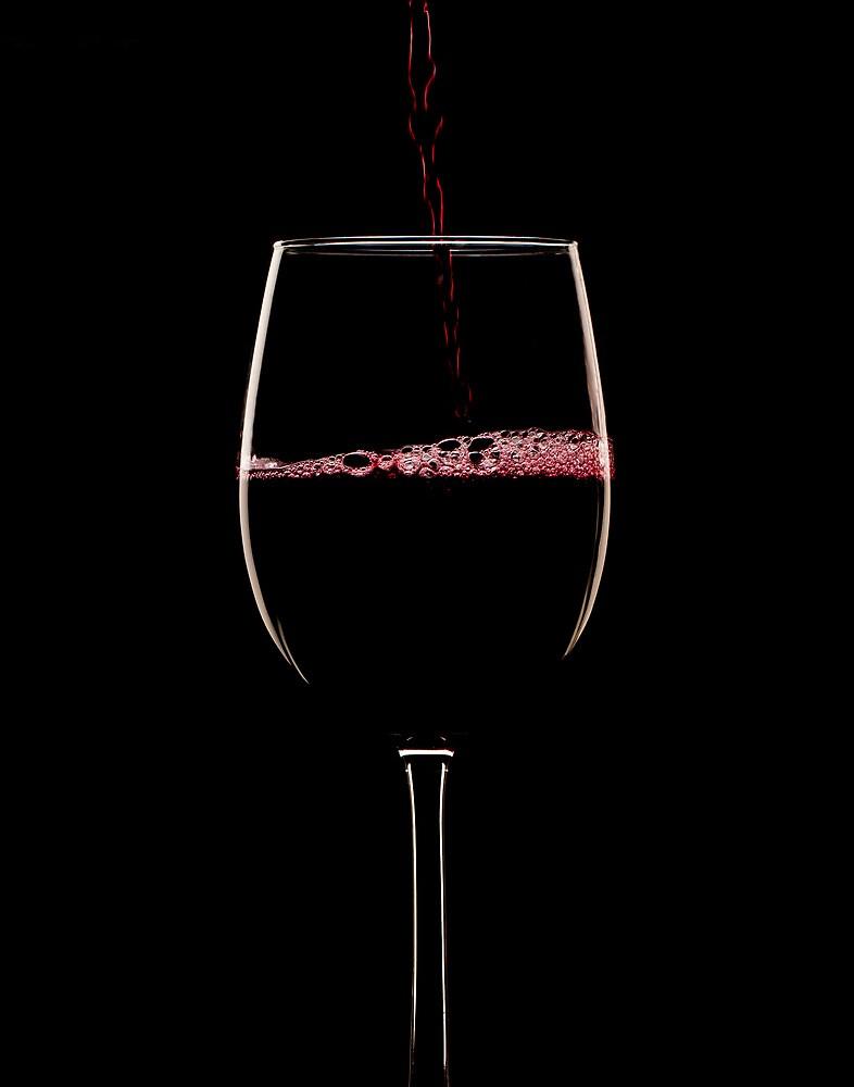 Red wine on black by Jerry Deutsch