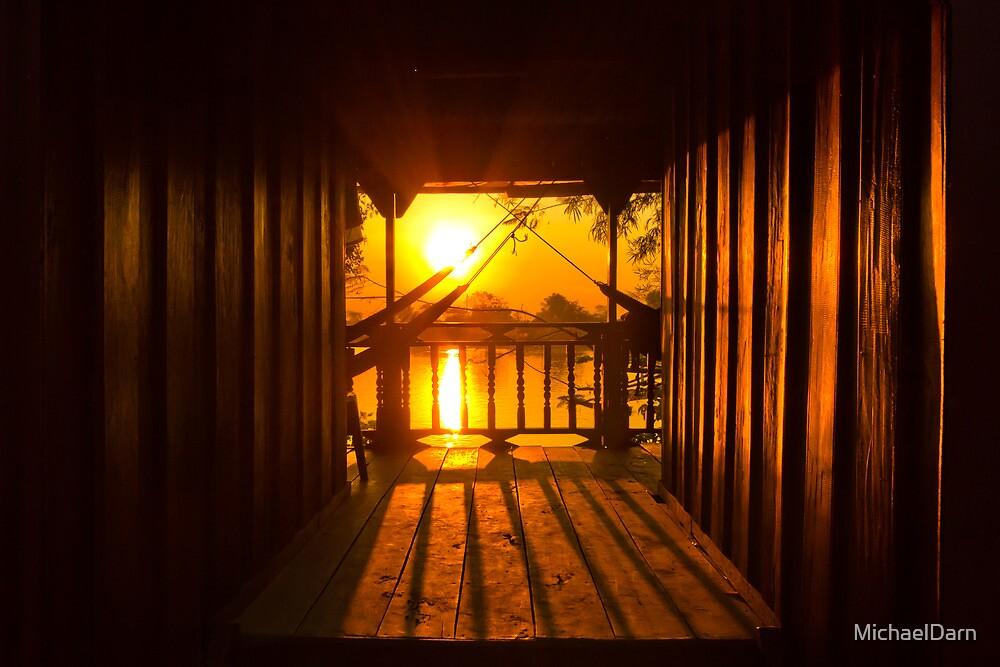 Sunset through bungalow by MichaelDarn