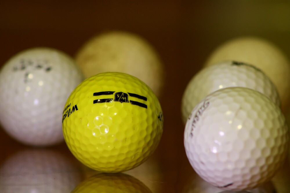 Golf balls by Jaime Cifuentes