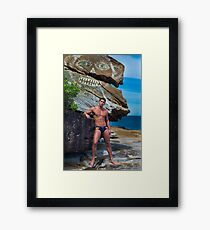 Man in speedos at beach with modern rock art Framed Print
