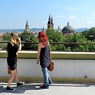 Blonde and Red Hair Girls Admiring Sibiu Roofs by ivDAnu