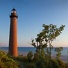 Little Sable Lighthouse by the shore near Silver Lake Michigan by Randall Nyhof