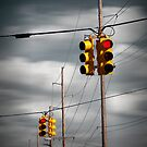 Waiting for the Traffic Light watching Gray Clouds flow by by Randall Nyhof