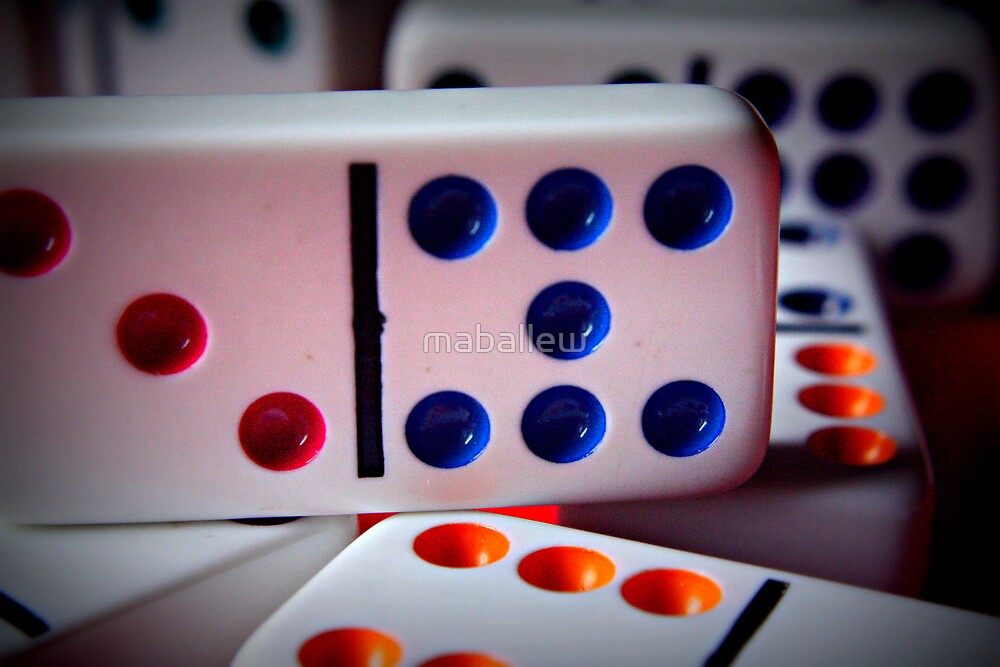 Domino game in play on family game night by maballew