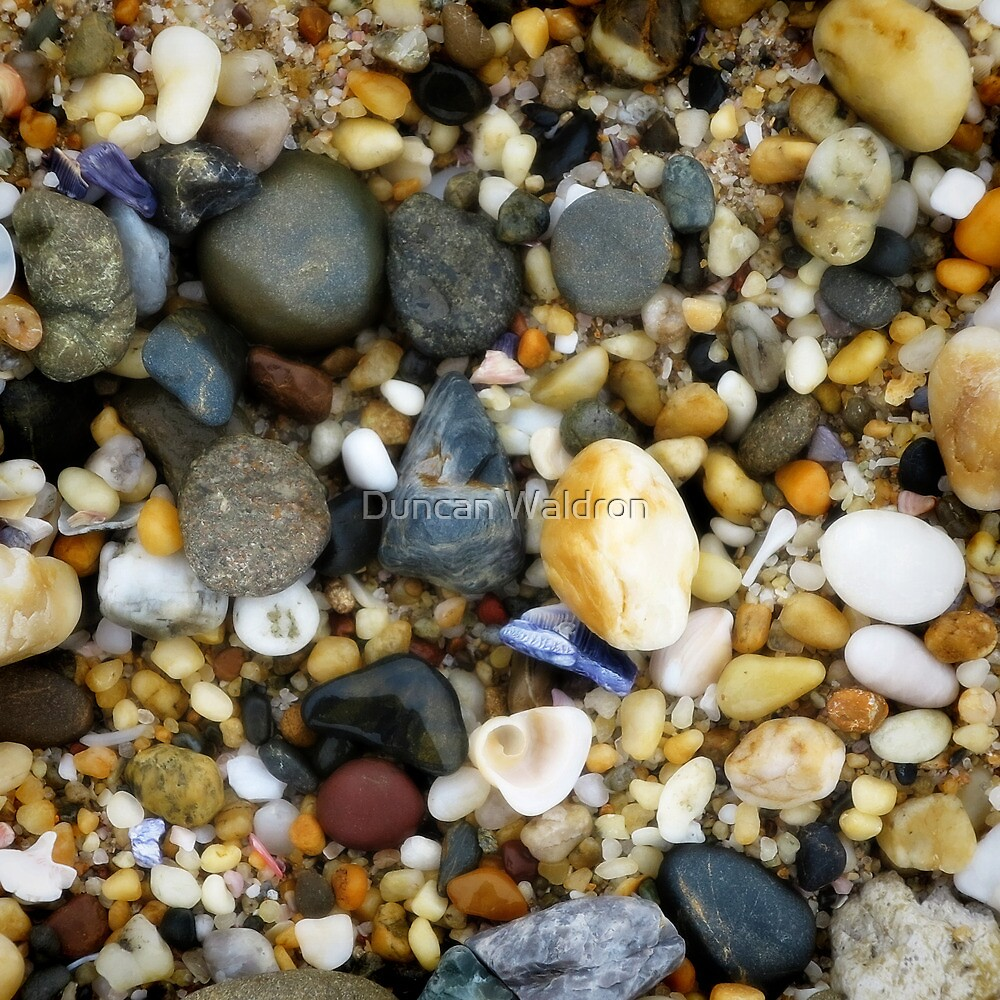 Wet pebbly beach by Duncan Waldron