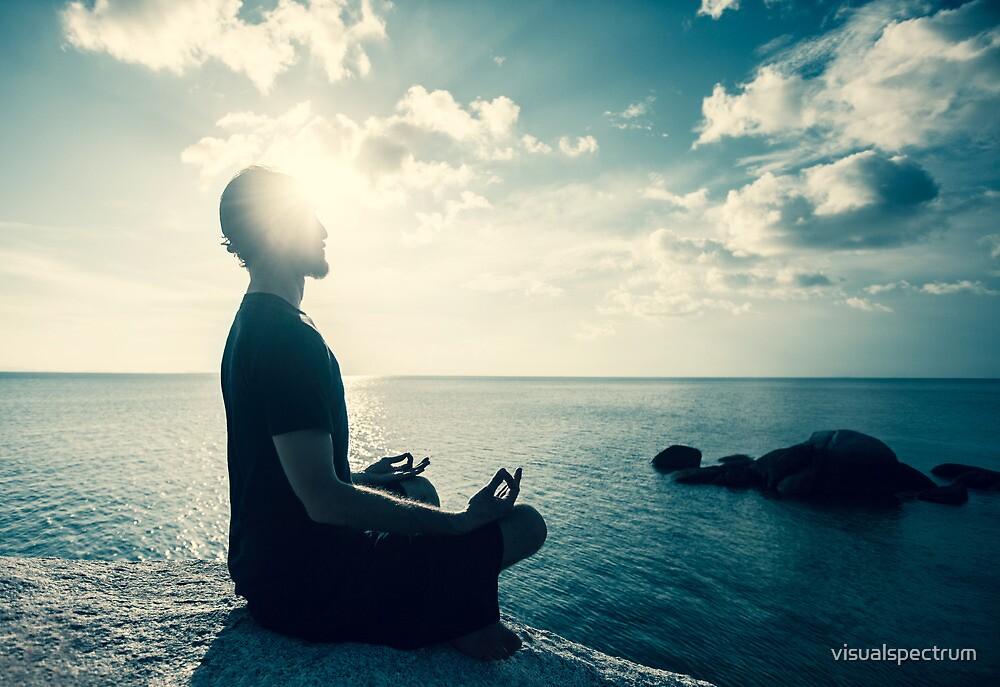 Man Meditating At Sunset by visualspectrum