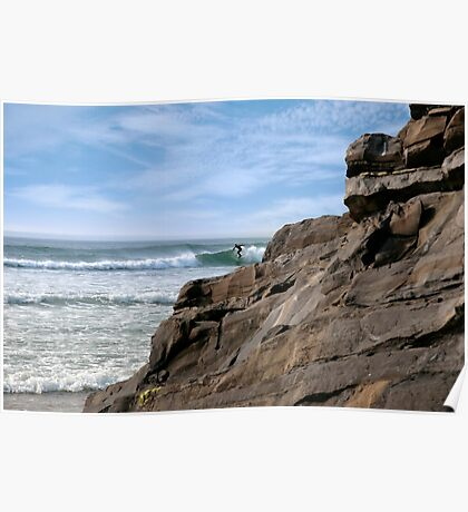 lone surfer near rocks Poster