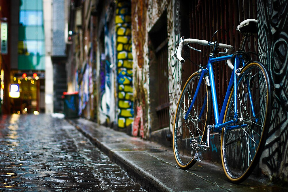 Bicycle in Wet Cobbled Lane by jamjarphotos
