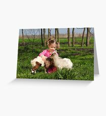 child play with two little goats Greeting Card
