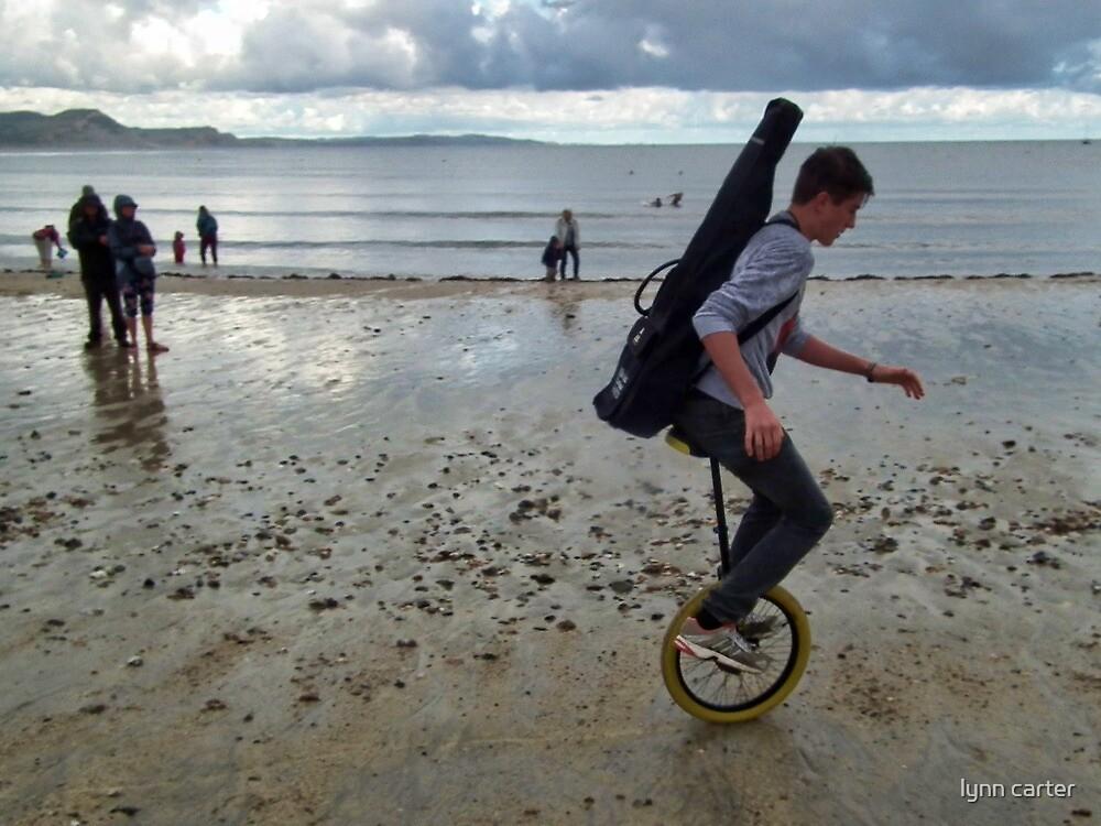Uni cyclist  On The Beach by lynn carter