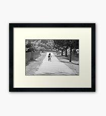 Bicycling girl Framed Print