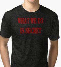 What we do is secret  Tri-blend T-Shirt