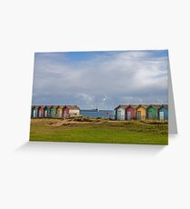 Beach huts with a view of Blyth Pier Greeting Card