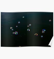 Soap bubbles landing on water. Poster