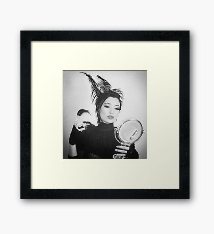 the bird is the word Framed Print