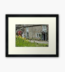 Cottage and phone box Framed Print