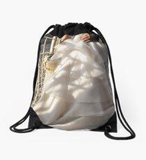 """a beautiful thing in a crumbling world"" Drawstring Bag"