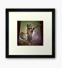 Cat playing guitar  Framed Print