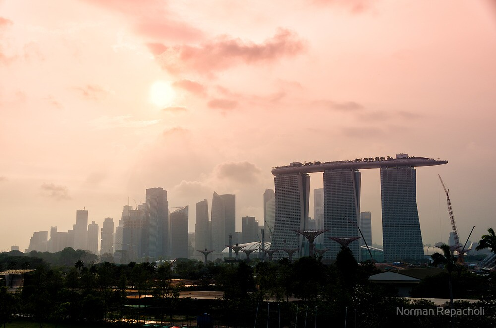 Approaching sunset over Marina Bay Sands - Singapore by Norman Repacholi