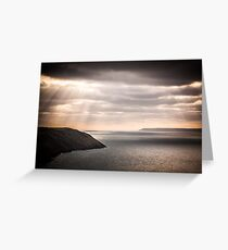 lundy island and baggy point on a dark afternoon Greeting Card