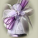 Small ceramic vase with white and purple ribbons by wildrain