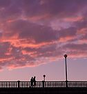Two people walking on a bridge, in the evening by OlivierImages