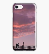 Two people walking on a bridge, in the evening iPhone Case/Skin