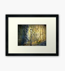 Lamposts along a spanish wall Framed Print