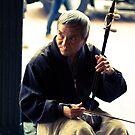 Erhu Street Musician by JAS Photography