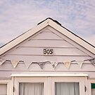 Beach hut in cream with bunting by Zoe Power