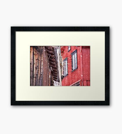 Red house in snow Framed Print