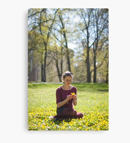 Girl picking flowers Canvas Print