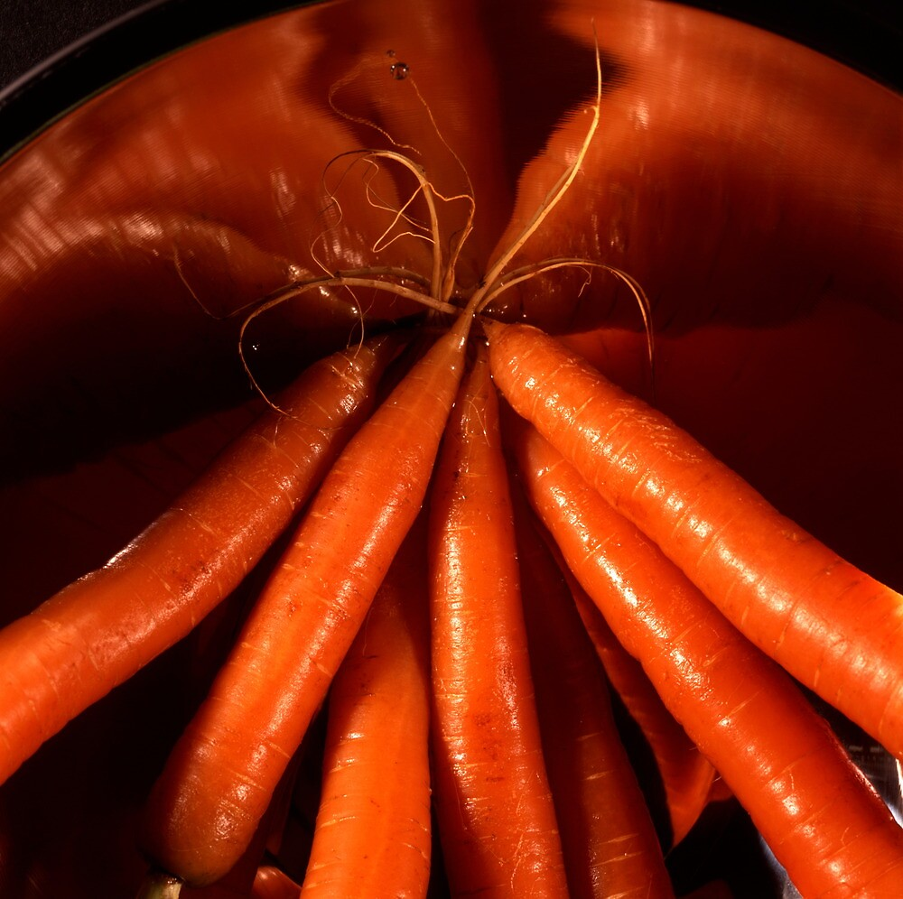Tasty carrots in a colander  by intensivelight