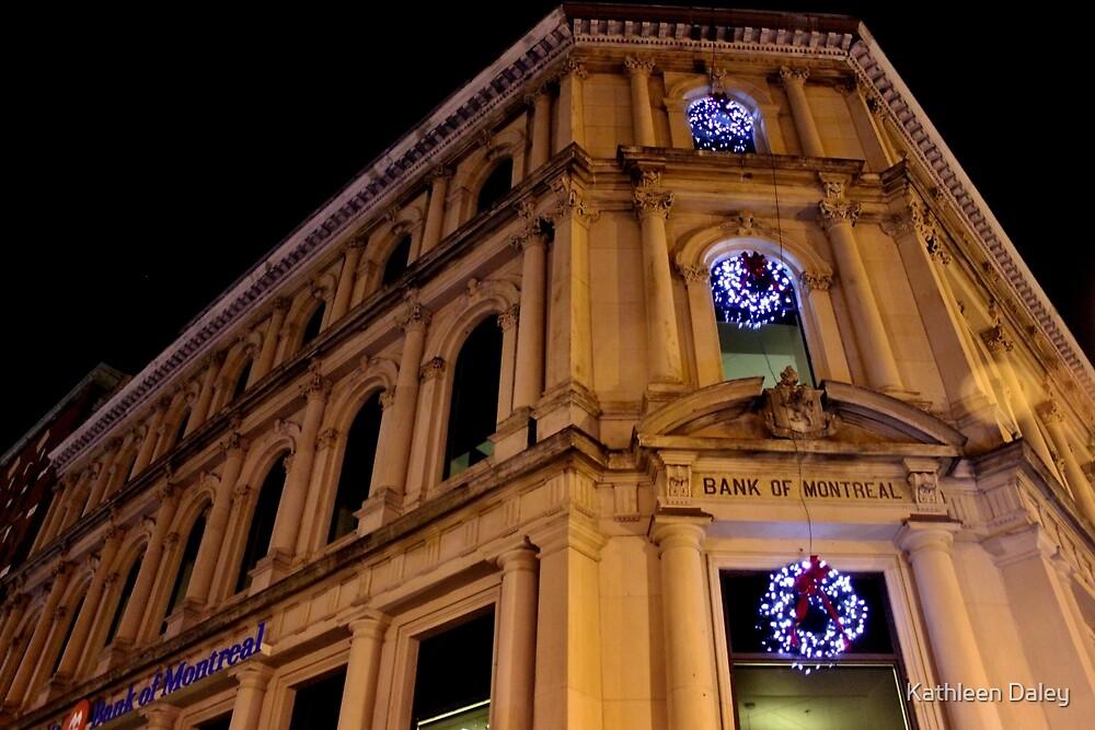 BMO at Night During the Christmas Season by Kathleen Daley