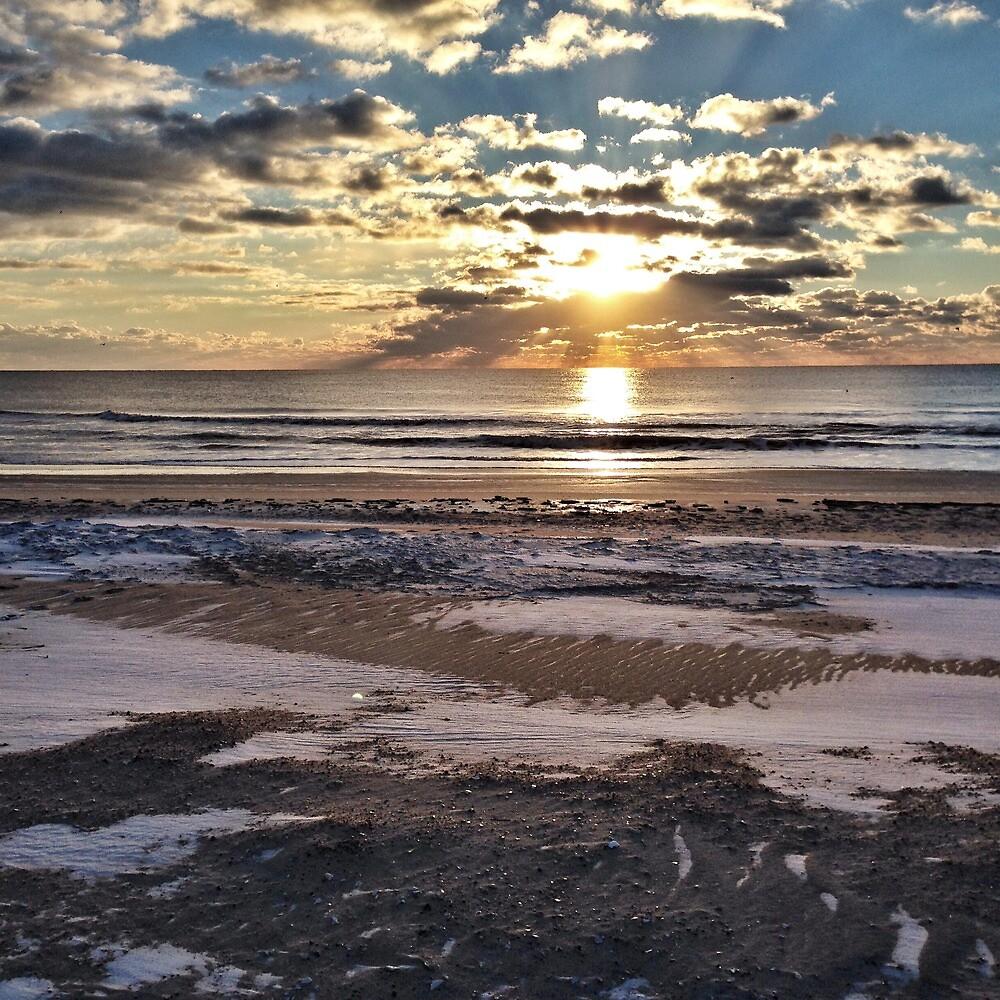 Sunrise Over Snowy Beach by jayhiatt
