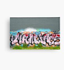 Abstract Graffiti on the textured brick wall Canvas Print