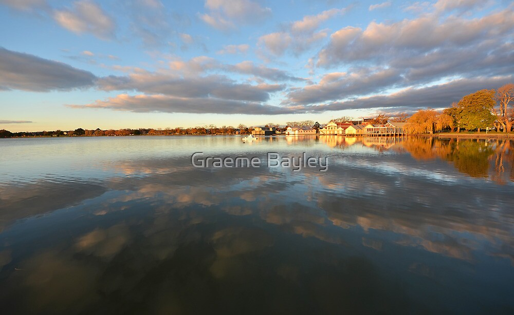 Boat Sheds by Sunset Lake by Graeme Bayley